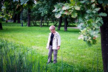 Boy walks in a city Park