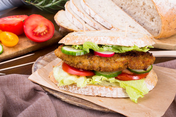 sandwich with fried meat and vegetables