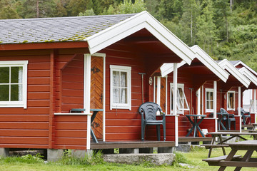 Traditional norwegian red wooden cabins facades. Travel