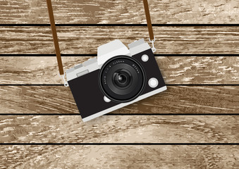 camera on wooden table