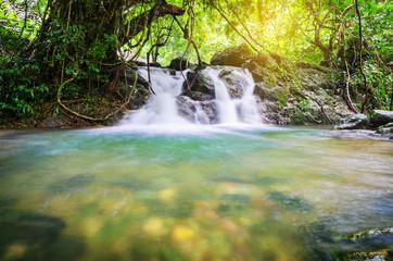 Beautiful waterfall with sunlight.