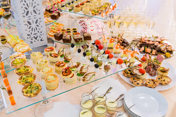 Delicacies, appetizers, wine, desserts at the Banquet. Buffet, catering service. On-site restaurant
