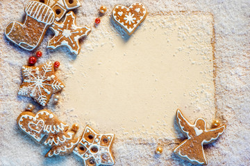 Gingerbread cookies with Christmas letter on snowy background. Merry Christmas and Happy New Year!! Top view.
