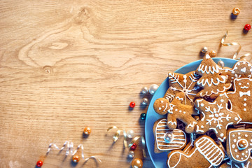 Plate with gingerbread cookies on wooden table. Merry Christmas and Happy New Year!! Top view.