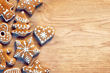 Gingerbread cookies on wooden table. Close up, top view. Merry Christmas and Happy New Year!!