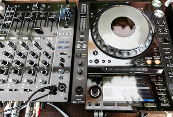 Fototapete - DJ CD player and mixer