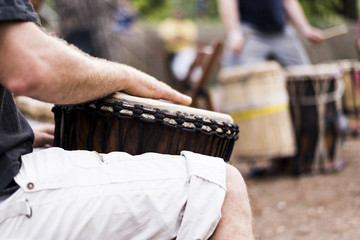 man playing the bongos, a traditional percussion instrument of African music