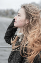 wind blowing hair young woman outside