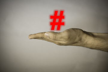 Human hand on vintage background with social symbol
