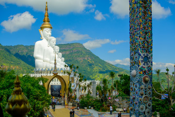 Big White Buddha Statue with mountain and blue sky background at Wat Phasornkaew in Thailand. Photo taken on: 29 November , 2016