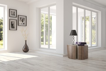 White room with modern furniture and green landscape in window. Scandinavian interior design