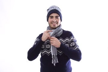 Young man with sweater, scarf and wool cap isolated