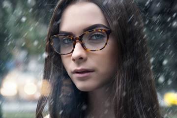 girl with glasses in the street, fashion, glamor winter theme