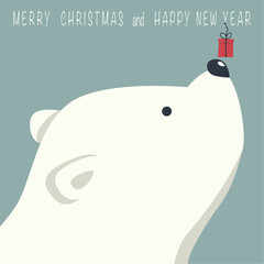 The cover design. Depicts face little polar bear with gift box. Phrase merry Christmas and a happy New year on blue background.