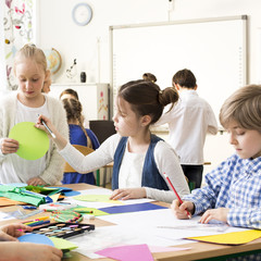 Pupils painting during art classes