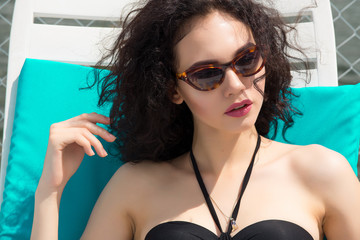 Beautiful  woman wearing bikini. Young girl model in sunglasses