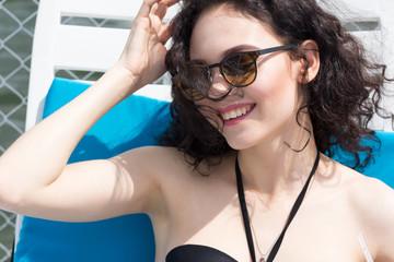 Beautiful  woman wearing bikini. Young girl model in sunglasses