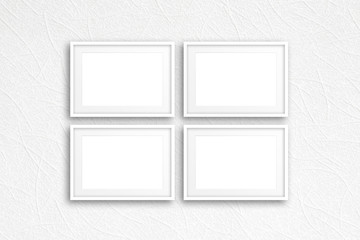 Four blank photo frames on modern textured wallpaper, interior decor mockup