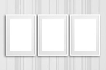 Three blank frames on striped design wallpaper,  interior decor mock up