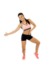 young beautiful latin woman in fitness clothes dancing zumba in aerobic workout happy and excited