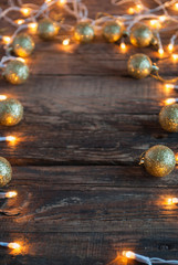 Christmas Lights and Decoration on Wooden Background. Vertical.