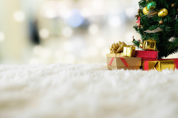 Christmas concept. Christmas decoration, Holiday decorations on snow with blur shopping center background. Soft focus,low light.(selective focus).