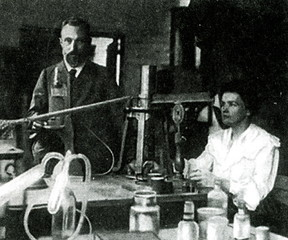 Pierre Curie and Marie Skłodowska-Curie, pioneers in radioactivity, in their laboratory