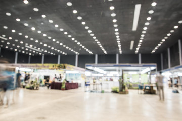 Exhibition Hall blurred background people walking with motion bl