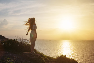 Free happy woman enjoying nature on sunset. Beauty Girl Outdoor. Freedom concept. Enjoyment