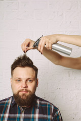 Casual man doing hair style, hairdresser hands