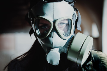 Portrait of a young woman wearing a gas mask