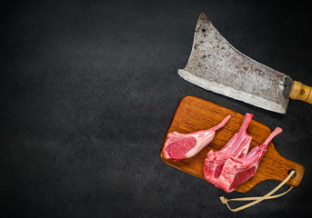 Raw Lamb Ribs with Meat Cleaver and Copy Space