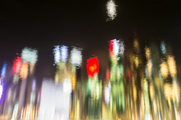 Abstract coloured water reflection in night city