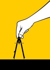 Man hand using geometry compass