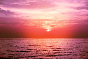 Background image of the beach in summer time. Beautiful sunset sky over the sea at tropical beach in the evening with red filter. copy space. Leam Sadej Beach, Chanthaburi, Thailand. copy space.