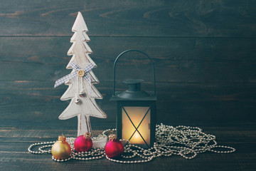 Wooden decorative New Year fir-tree, Christmas lamp and glass spheres on a wooden background. Christmas decoration, holidays, new year and decor concept.