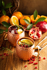 Christmas Moscow mule with pomegranate and orange