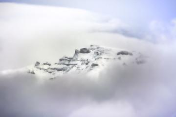 winter in romanian Carpathians mountains in a cloudy day. Pestera, Magura, Bran, Brasov. winter season 20015 / 20016
