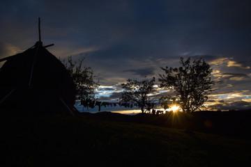 Evening sunset on mountain hills of Simon village. Bran.