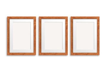 Three blank photo frames, light brown wooden design