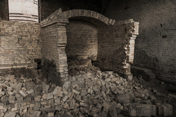 destroyed the furnace in an abandoned building. boiler room. a lot of old bricks is a bunch.