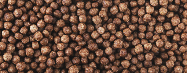 Chocolate corn balls flakes. Panorama.