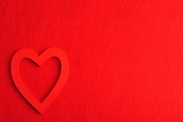 Valentine's Day. A red heart isolated against a red background