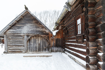 Traditional rural wooden house in winter