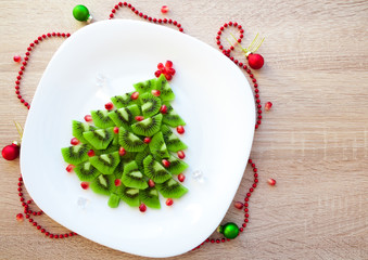 Fruit Kiwi Christmas tree - New Year food background top view blank space for text