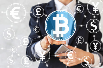Businesswoman touched bitcoin symbol on touch screen on background of network currency. Businessman presses bitcoin button. Finance web concept, internet, money, technology, stock, cryptocurrency.