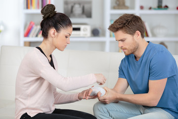gentle woman helps her injured boyfriend