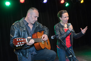 couple of musician playing at a concert together