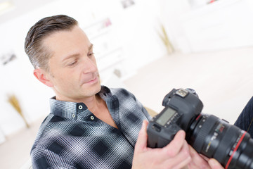 portrait of a confident photographer holding camera