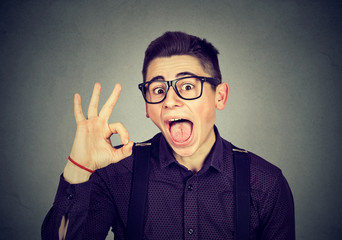 Nerdy funny man showing ok sign